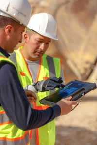 Warehouse workers with rugged tablets